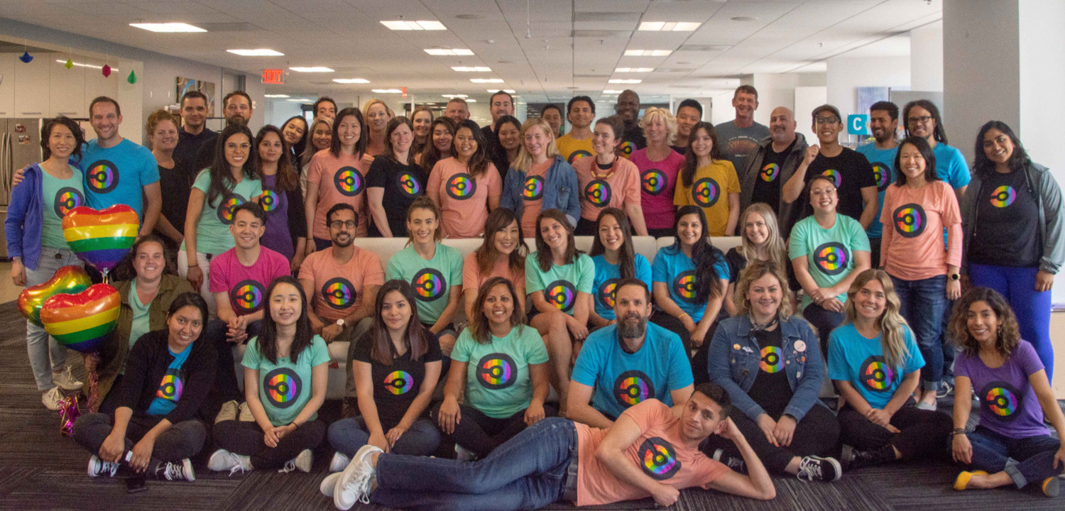 Team members dressed up in matching shirts as part of our annual Pride celebration.